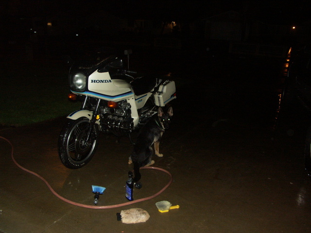 washing the bike, at night, with my girl Rain